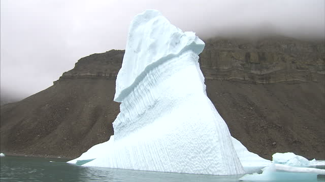 exterior shots of a iceberg floating in the sea on august 25 2007 in cambridge bay canada - sea passage stock videos and b-roll footage