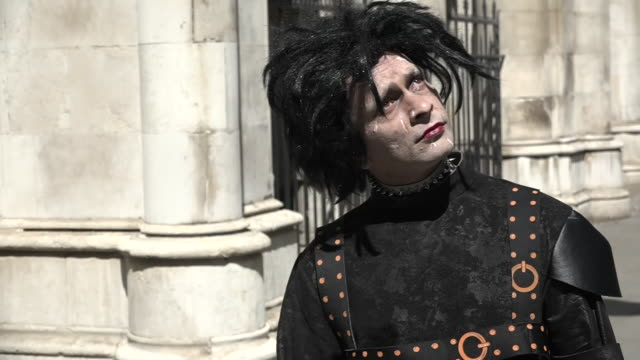 exterior shots of a johnny depp fan dressed up as edward scissorhands arriving at the high court on 17th july 2020 in london united kingdom - johnny depp stock videos & royalty-free footage