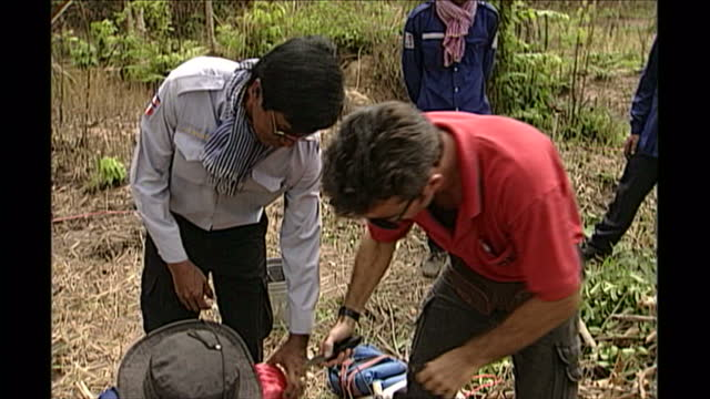 exterior shots of a landmine being discovered and safely removed from the ground on april 27th 1998 in phnom penh cambodia - land mine stock videos and b-roll footage