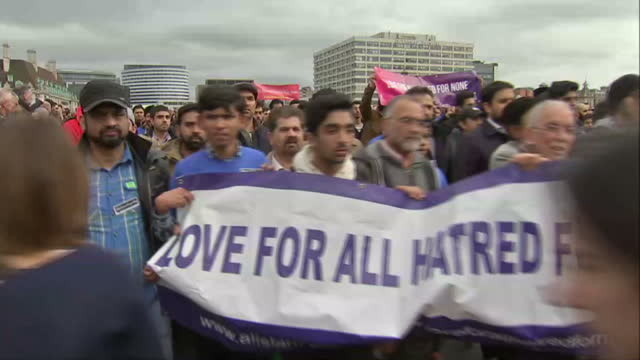 exterior shots of a large crowd of demonstrators crossing westminster bridge carrying a large banner 'love for all hatred for none' in response to... - memorial event stock videos and b-roll footage