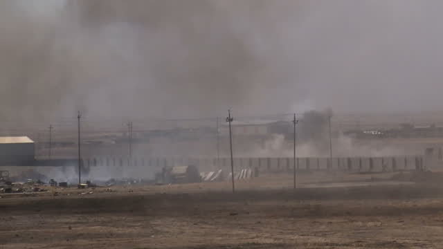 exterior shots of a large explosion and sounds of gunfire during a live battle between iraqi forces and is on 24 march 2017 in mosul, iraq - イラク点の映像素材/bロール
