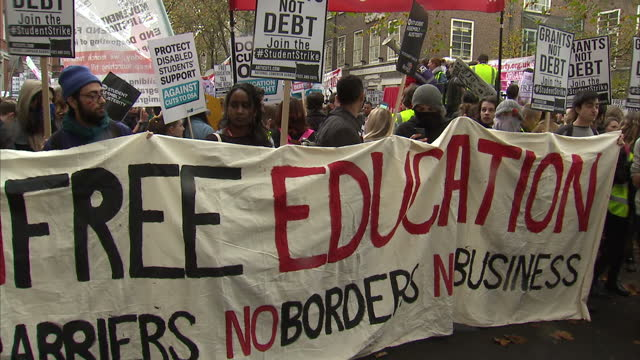 Exterior shots of a large gathering of protesters holding placards and banners including a large 'Free Education' banner on November 04 2015 in...