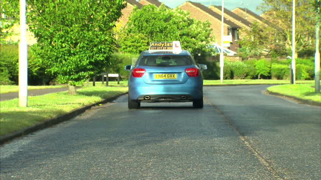 exterior shots of a learner driver drivng around a residential area and conducting different maneuvers on may 31 2015 in london england - driving test stock videos and b-roll footage