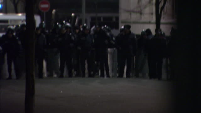 Exterior shots of a line of police with riot shields in standoff with line of antiRussia protesters forming cordon in Kiev Protesters in Kiev...