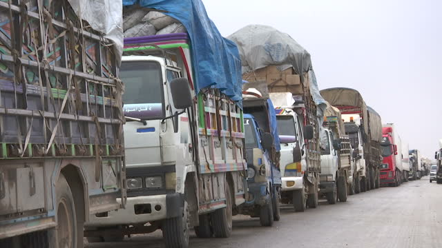 exterior shots of a line of trucks and refugees from raqqa parked along a roadside, on the syrian frontline near ayn isa on december 18, 2015 in ayn... - 2015 stock videos & royalty-free footage