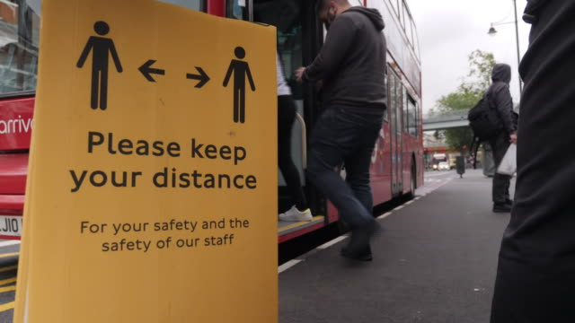 exterior shots of a london bus stop with signs advising of social distancing measures and an nhs rainbow painted on the road on 9 july 2020 in... - public transport stock videos & royalty-free footage