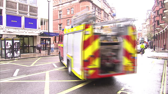 exterior shots of a london fire brigade fire engine inside a fire station and responding to emergency on october 6 2010 in london england - fire engine stock videos & royalty-free footage