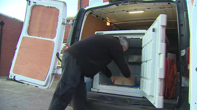 exterior shots of a man taking a box of new pfizer coronavirus vaccines from a freezer compartment in the back of a van and handing the box to... - giving stock videos & royalty-free footage