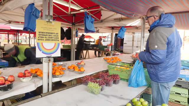 exterior shots of a marketplace fruit and vegetable stall with stallholders selling produce on 26 february 2021 in northampton, united kingdom - selling stock videos & royalty-free footage