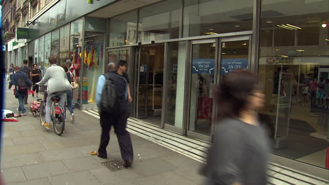 exterior shots of a marks and spencer store in hammersmith as shoppers walk in and out on september 03 2016 in london england - employment issues stock videos & royalty-free footage