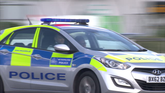 exterior shots of a metropolitan police car as it drives down busy road responding to a 999 emergency call on july 8 2014 in london england - fire engine stock videos & royalty-free footage