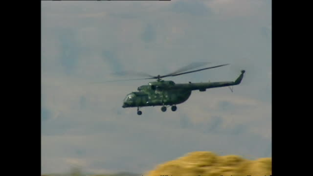 exterior shots of a military helicopter flying past white mountains during the us uk led invasion of afghanistan on october 29 2001 in kabul... - afghanistan stock videos & royalty-free footage