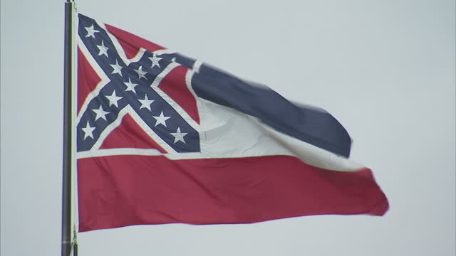 exterior shots of a mississippi state flag flying featuring the confederate cross on 21 february 2017 in jackson mississippi - confederate flag stock videos & royalty-free footage