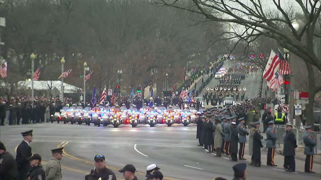 Exterior shots of a motorcade carrying President Elect Donald Trump en route to the White House on January 20 2017 in Washington DC