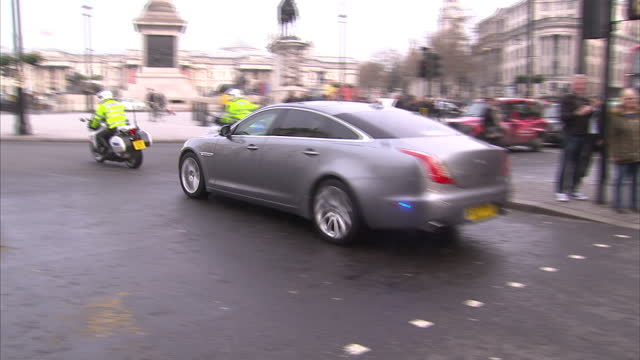 exterior shots of a motorcade carrying prime minister theresa may passing through a police cordon on whitehall on march 23 2017 in london england - motorcade stock videos & royalty-free footage