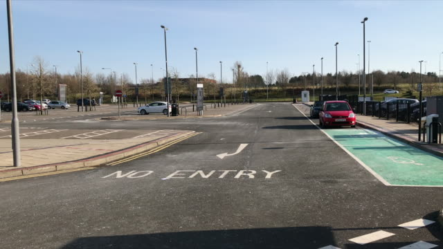 exterior shots of a nearly empty car park outside a major retail complex due to the coronavirus outbreak on 22 march 2020 in livingstone, scotland - industry stock videos & royalty-free footage