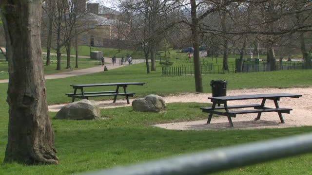 exterior shots of a nearly empty heaton park with a few visitors taking walks and cycling on 10 april 2020 in manchester, england. - natural parkland stock videos & royalty-free footage