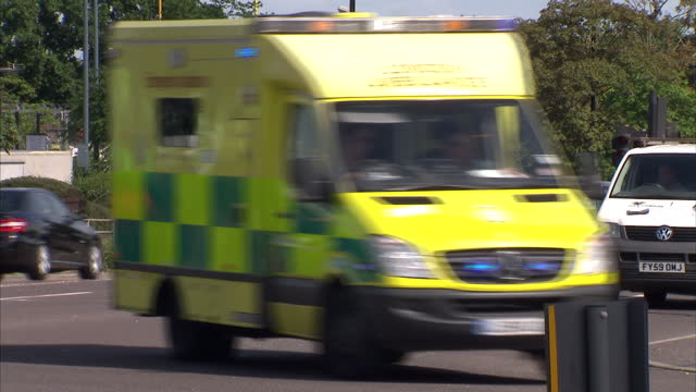 Exterior shots of a NHS Ambulance as it drives down busy road responding to a 999 emergency call on July 08 2014 in London England