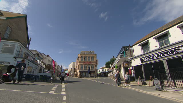 exterior shots of a novelty tourist road train and people walking through newquay town centre on 20 july 2017 in newquay united kingdom - tourist train stock videos and b-roll footage