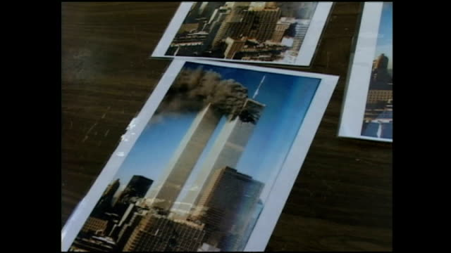 stockvideo's en b-roll-footage met exterior shots of a pavement vendor selling pictures of the twin towers after the first plane struck on september 24, 2001 in new york city. - petronas twin towers