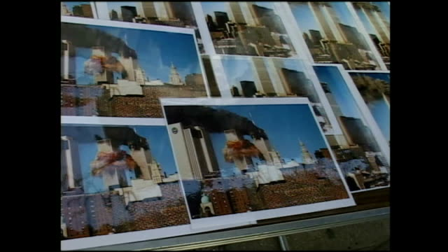 exterior shots of a pavement vendor selling pictures of the twin towers after the first plane struck on september 24 2001 in new york city - petronas twin towers stock-videos und b-roll-filmmaterial