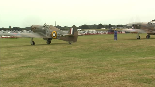 exterior shots of a pilot in the cockpit of a spitfire mk xiv and hurricanes & spitfire mk xiv taxi off on airfield on august 18, 2015 at biggin hill... - biggin hill stock videos & royalty-free footage