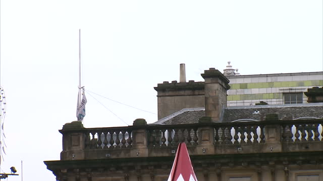exterior shots of a police cordon opposite glasgow's george square and flags flying at half mast after monday's bin lorry tragedy in which six people... - seilabsperrung stock-videos und b-roll-filmmaterial