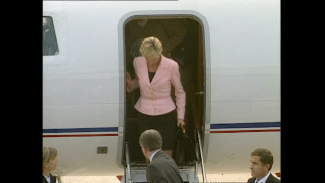 Exterior shots of a private jet taxiing on runway and shots of Princess Diana Princess of Wales getting off plane and greet officials on October 12...