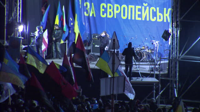 Exterior shots of a protest leader on stage addressing crowds during anti Russia protests in Independence Square Kiev Protest leader on stage...