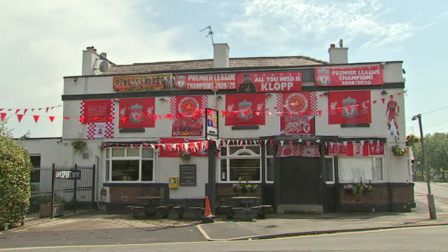 exterior shots of a pub decorated in liverpool flags and posters, celebrating their 2019/20 premier league title win. - flag stock videos & royalty-free footage