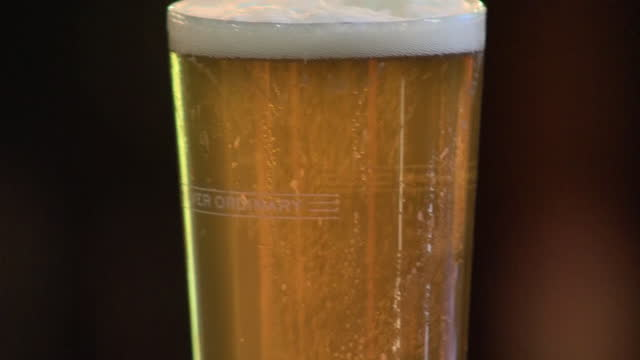 exterior shots of a pub landlord delivering a pint of real ale and glass of belgian style beer to an outside table at the kentish belle pub as... - pint stock-videos und b-roll-filmmaterial