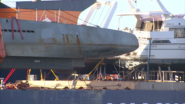 Exterior shots of a replica UBoat to be featured in the forthcoming Sky TV drama series Das Boot in La Rochelle harbour being winched into the water...