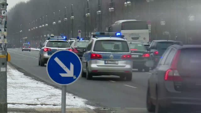 Exterior shots of a road approaching the Victory Column in Berlin and a motorcade carrying German Chancellor Angela Merkel driving past on January 18...
