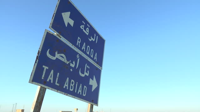 exterior shots of a road sign in syria to raqqa and tal abiad on december 18, 2015 in ayn isa, syria. - 2015 stock videos & royalty-free footage