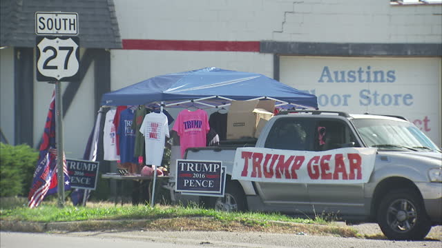 Exterior shots of a roadside stall in Ohio selling 'Trump gear' including 'Build that Wall' tshirts and other Donald Trump related merchandise on...