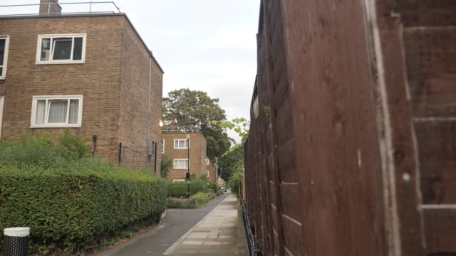 exterior shots of a run down estate and security in and around the estate on 18 september 2019 in london, united kingdom. - public housing stock videos & royalty-free footage
