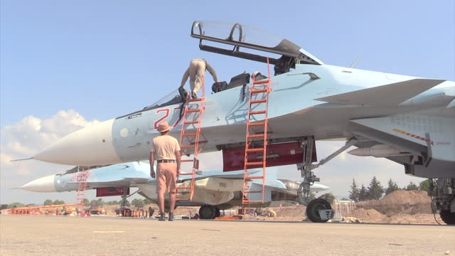Exterior shots of a Russian air force crew at Latakia airbase readying a Sukhoi Su30 Flanker for flight on December 21 2015 in Latakia Syria