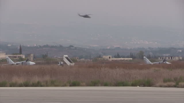 Exterior shots of a Russian air force Mi24 Hind helicopter gunship flying past at Latakia airbase on December 21 2015 in Latakia Syria