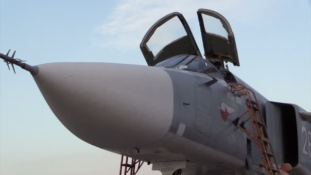 Exterior shots of a Russian air force Sukhoi Su23 Fencer being loaded with conventional bombs at Latakia airbase on December 21 2015 in Latakia Syria