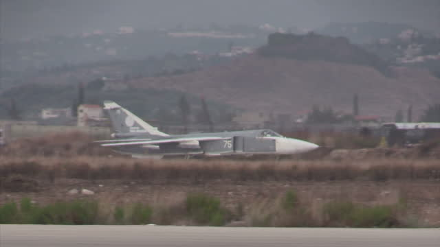 Exterior shots of a Russian Air Force Sukhoi Su23 Fencer bomber taxiing at Latakia airbase on December 21 2015 in Latakia Syria