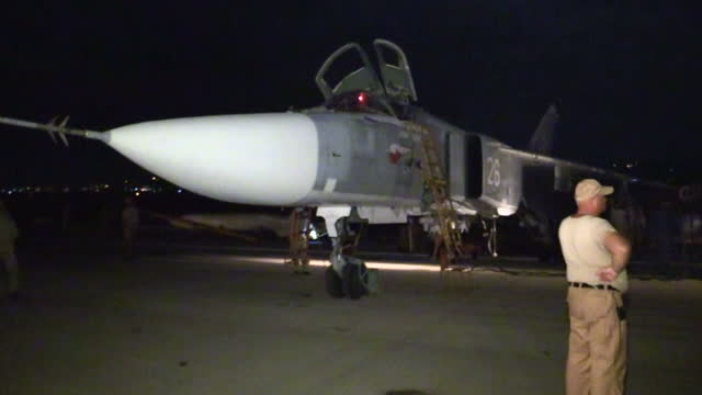 Exterior shots of a Russian Air Force Sukhoi Su23 Fencer bomber being prepared for a raid on targets in Syria on the Latakia airbase on December 21...