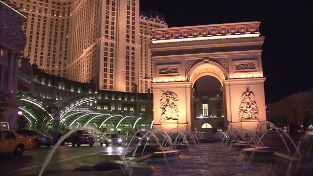exterior shots of a scaled down replica of the arc de triomphe arch outside paris las vegas hotel and casino on november 19, 2012 in las vegas,... - paris las vegas stock videos & royalty-free footage