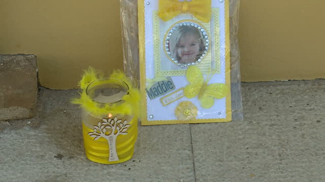 exterior shots of a small candlit tribute to madeleine mccann outside praia da luz church on 3 may 2017 in praia da luz portugal - madeleine mccann stock videos & royalty-free footage