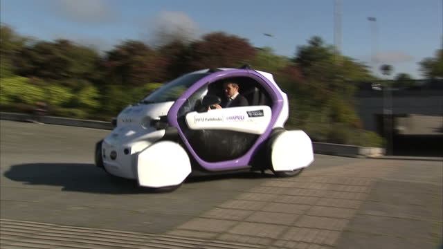 exterior shots of a small driverless car being tested in milton keynes driving a circuit along pathways near milton keynes station >> on october 11... - driverless car stock videos & royalty-free footage