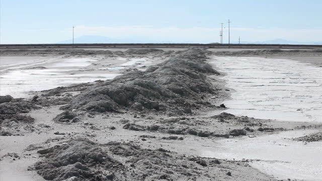 exterior shots of a small lake on the outskirts of wendover with traffic passing on interstate 80 in the distance and a mountain range then salt... - bonneville salt flats stock videos and b-roll footage