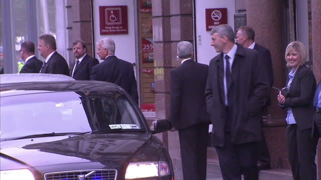 exterior shots of a smiling tony blair walking from a bookshop in dublin to waiting car after a book signing to jeers from protesters who are held... - tony blair stock-videos und b-roll-filmmaterial