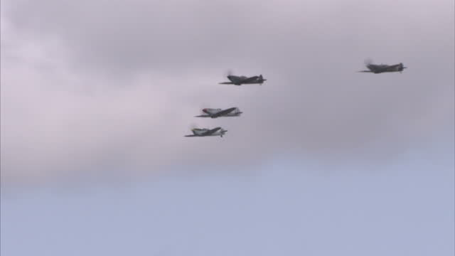 exterior shots of a spitfires flying in formation at the royal international air tattoo on july 17 2015 in fairford england - raf fairford stock videos and b-roll footage