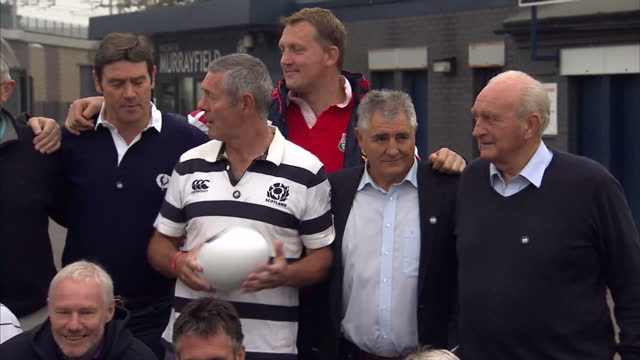 exterior shots of a squad of scottish rugby legends replicated the national sides iconic 1990 march on to the murrayfield turf as they took part in... - zolla video stock e b–roll