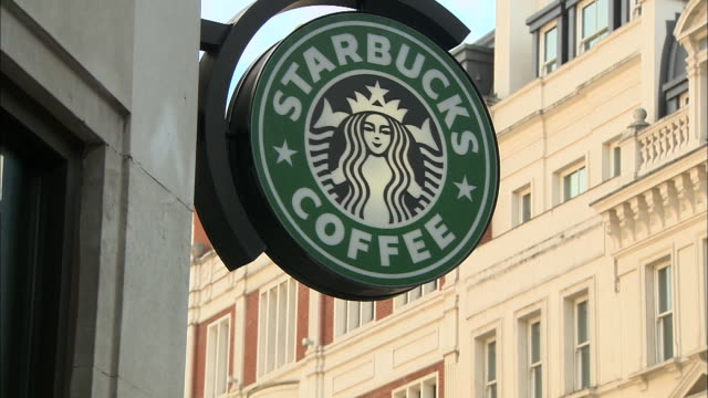 stockvideo's en b-roll-footage met exterior shots of a starbucks coffee shop. - healthcare and medicine or illness or food and drink or fitness or exercise or wellbeing
