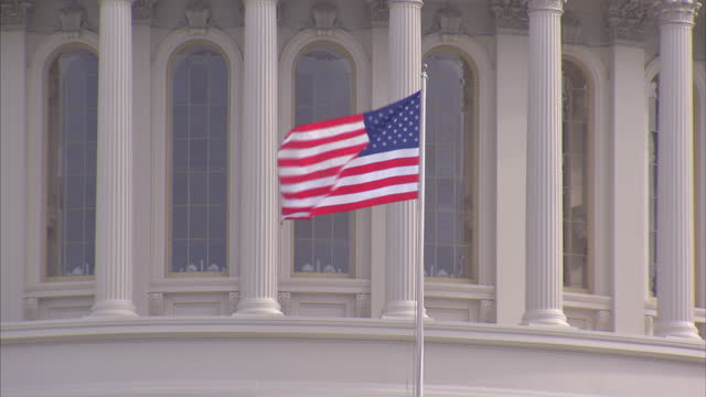 Exterior shots of a Stars and Stripes flag flying in front of the Capitol Building on January 16 2017 in Washington DC